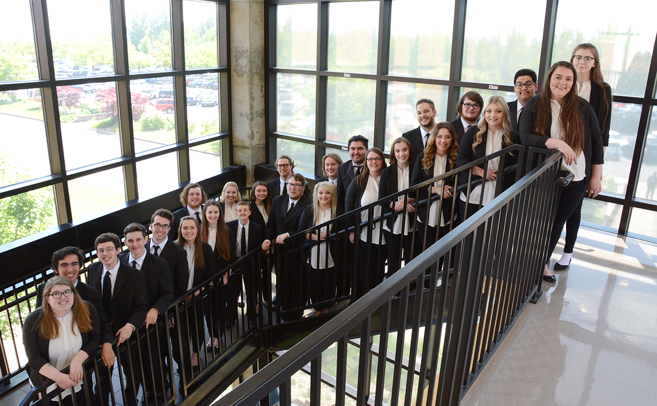 Choir on Stairs in Madrone Hall