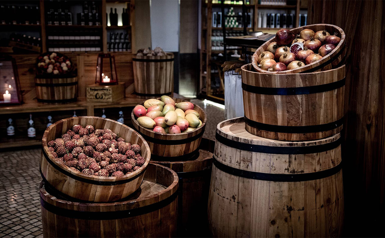 Wooden baskets and barrels filled with fruit