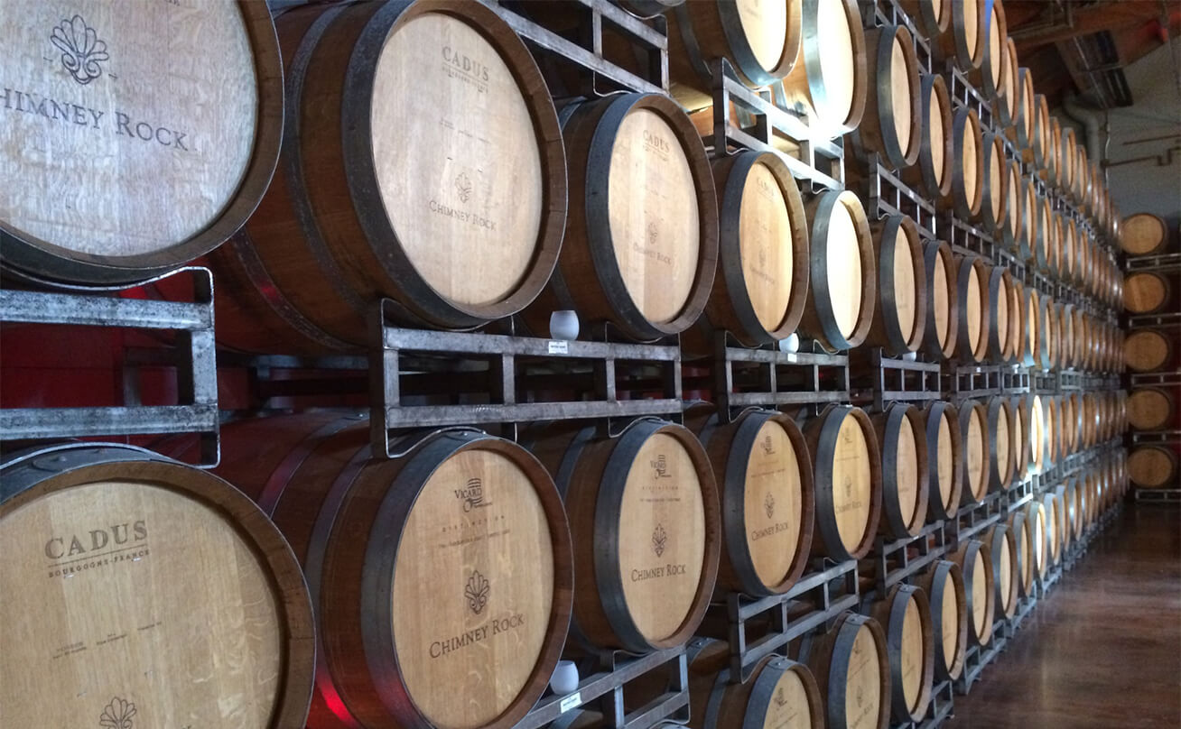 Rows of wine barrels