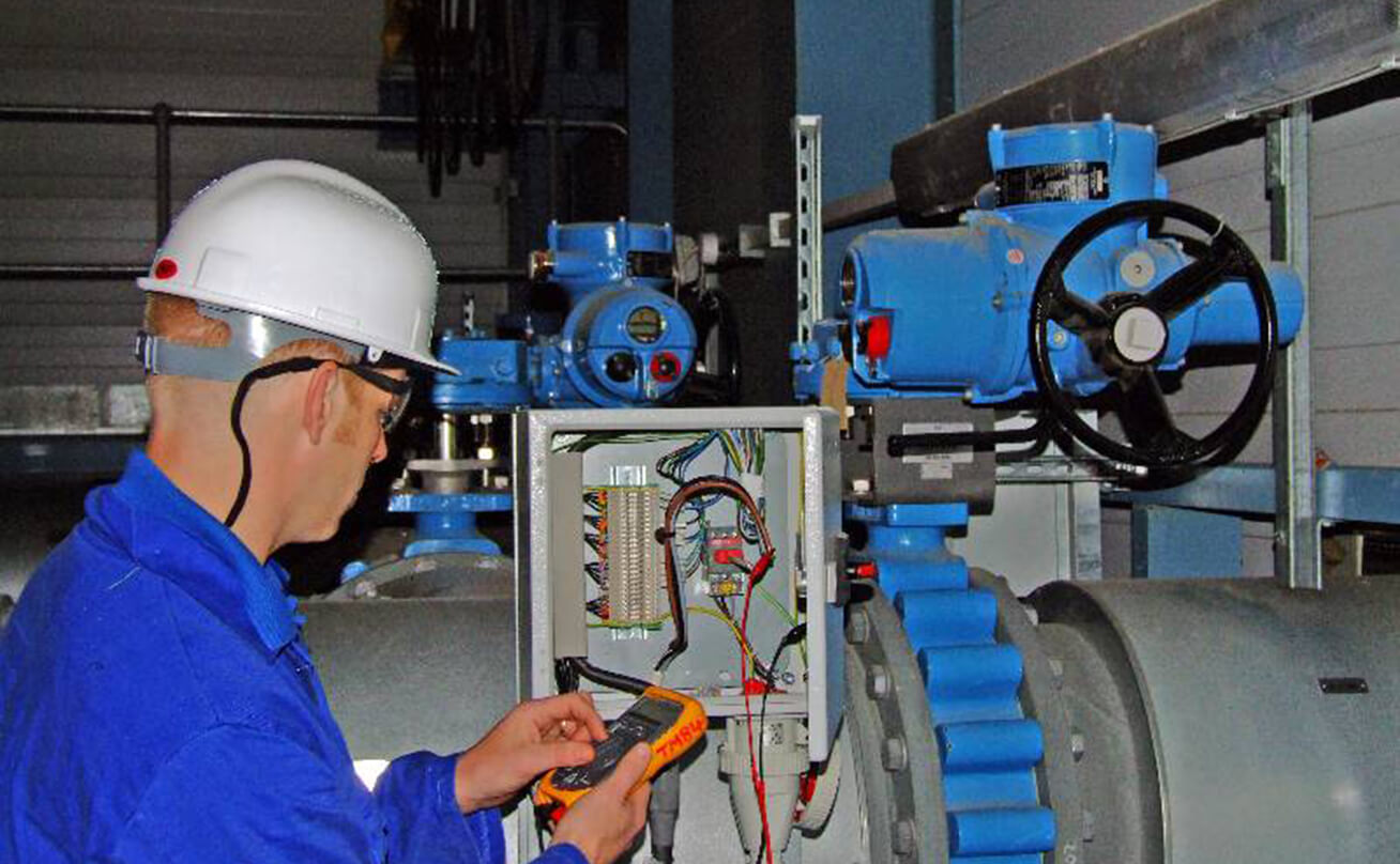 Student on-site at industrial facility in hardhat