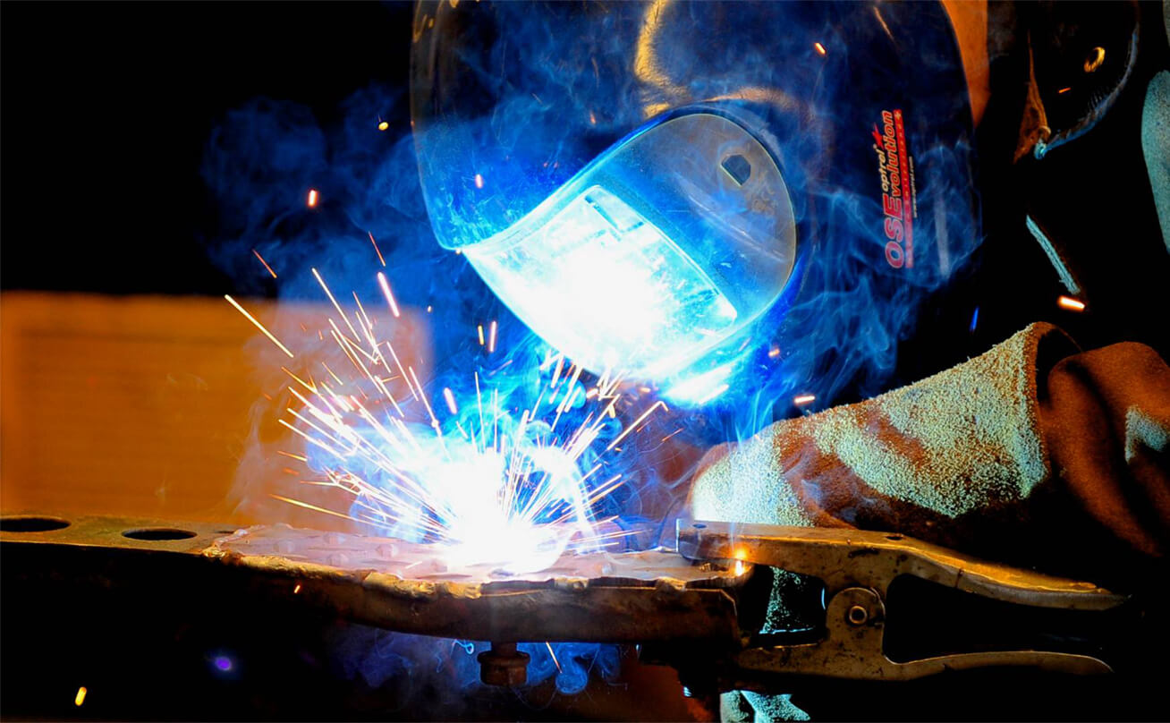 Welding with torch and mask